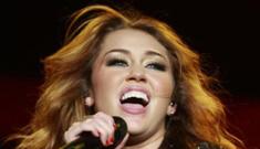 Miley Cyrus performs for tweens in skintight leotard