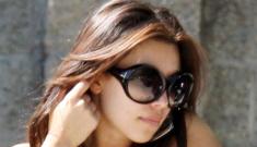 Kim Kardashian acts coy, tries to hide her moneymaker…?
