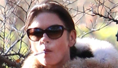 Catherine Zeta-Jones hides her cigarettes when she realizes she's being pap'd