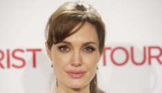 Angelina Jolie's bangs trauma & fuzzy cardigan: tragic or cute?