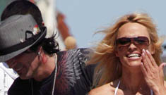 Pamela Anderson and Tommy Lee are living together, but aren't a couple