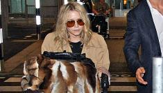Olsen twins bring triple their weight in luggage to London