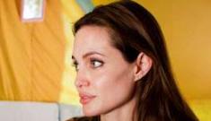 Angelina Jolie confirms her latest lat-longitude tattoo is Brad's birthplace