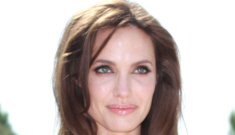 Angelina Jolie in a beige, belted sack for the Cannes KFP 2 photo call: cute?