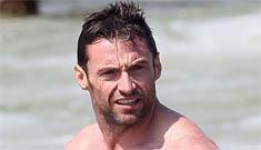 Shirtless Hugh Jackman hits the beach