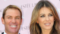 Liz Hurley flashes her giant sapphire engagement ring with Shane Warne