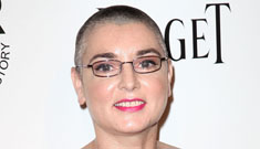 Sinead O'Connor shows off her tats and freshly shaved head in a Leger dress