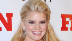 Jessica Simpson in red Donna Karan at a NYC event: lovely and glowing?