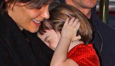 Suri Cruise looked deeply upset by the paparazzi last night