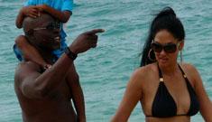 Kimora Lee Simmons and Djimon Hounsou show off  their hard beach bodies