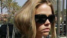 Denise Richards throws a laptop off a balcony, hits a senior in a wheelchair!