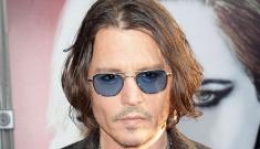 Johnny Depp at the LA premiere of 'Dark Shadows': oddly smooth & waxy?