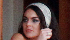 Lindsay Lohan is already falling out of her dress while filming 'Liz & Dick'.  Of course.