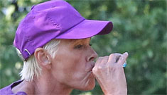Brigitte Nielsen acts like the photos of her drunk in the  park were a one time thing