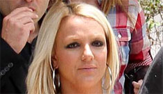 Does Britney have cold feet about getting married and is she putting off her wedding?