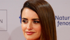 Penelope Cruz in vintage red Gianni Versace: very hot or   too matchy matchy?