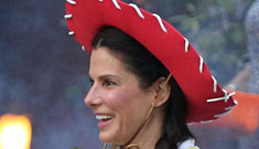 Sandra Bullock and Louis dress up as Toy Story characters for Halloween