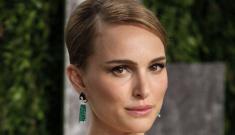 Natalie Portman in Dior at the Vanity Fair Oscar party: suspiciously bumpy?