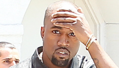 Kanye West bumps his head on a sign, then freaks out on a paparazzo