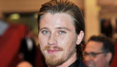 Garrett Hedlund trades in Christian Grey for Angelina Jolie's whip of doom