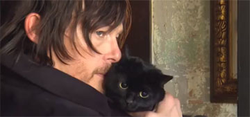"""Norman Reedus poses with his sweet black cat, """"Eye in the Dark"""": sexy and cute?"""