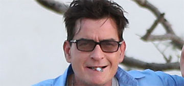 Charlie Sheen granted supervised visitation with twins, won't be charged with contempt