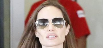 Angelina Jolie wore an oversized sack-poncho at LAX with Zahara & Maddox