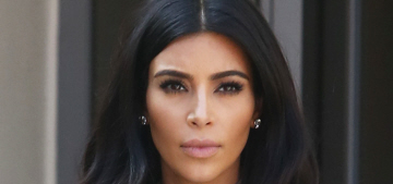 Kim Kardashian in a red ribbed skirt & grey bodysuit: unflattering or not bad?