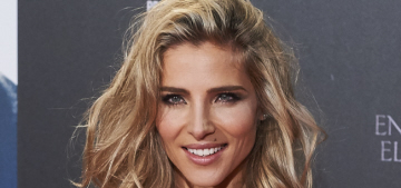 Elsa Pataky poses hard while Chris Hemsworth complains about the paparazzi