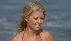 Tara Reid nearly falls out of her bikini