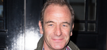 British TV star Robson Green has reportedly 'run off' with the vicar's wife