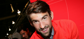 Michael Phelps calls changing his two week old baby's diaper 'a milestone'
