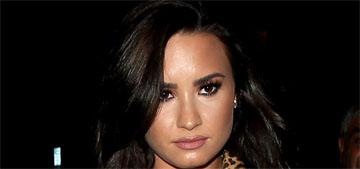 John Mayer had his arm around Demi Lovato at a club: makes sense?