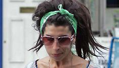 """Amy Winehouse suffers """"exhaustion,"""" cancels rest of tour"""