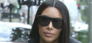 Kim Kardashian's getting her stretch marks removed & belly button 'tightened'
