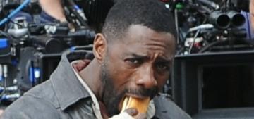 Please enjoy these photos of Idris Elba eating a hot dog as The Gunslinger