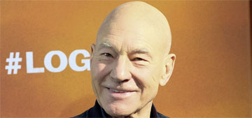 Patrick Stewart lets his foster pit bull, Ginger, sleep in his bed
