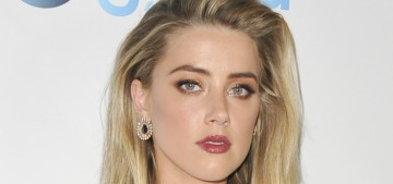 Amber Heard was making out with some mysterious, hunky Aussie rando
