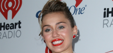 Miley Cyrus scolds 'rude' people calling her pregnant in a seemingly staged photo