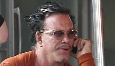 Mickey Rourke shows off his huge pecs