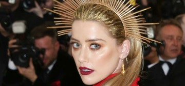 Amber Heard & Anne Hathaway did red gowns with gold headpieces at the Met Gala