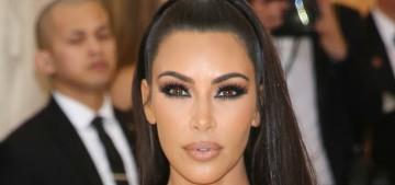 Kim Kardashian wore gold Versace to the Met Gala & it was surprisingly… okay?