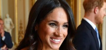 Duchess Meghan got buttony in Prada for an event at Buckingham Palace