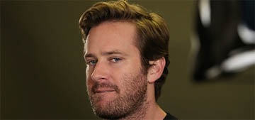 Armie Hammer keeps getting handed peaches to sign by fans