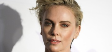 Charlize Theron says she's single, which means she's totally not into Brad Pitt