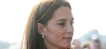 Duchess Kate wears red Carolina Herrera during a surprise trip to Belfast
