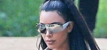 Kim Kardashian wore an enormous trench coat & Yeezys to church in Calabasas
