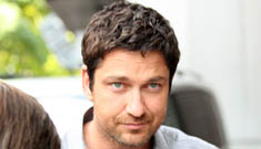 Gerard Butler doesn't want to be photographed checking out models