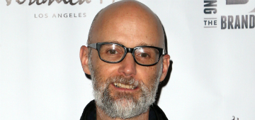 Moby got giant tattoos on both arms that say 'animal rights'