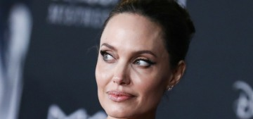 Angelina Jolie met a young British actor who has her face tattooed on his arm